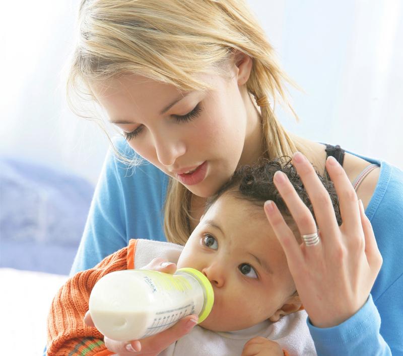 little child drinking yogurt or kefir over white